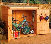 Cobertizo de madera para guardar bicicletas